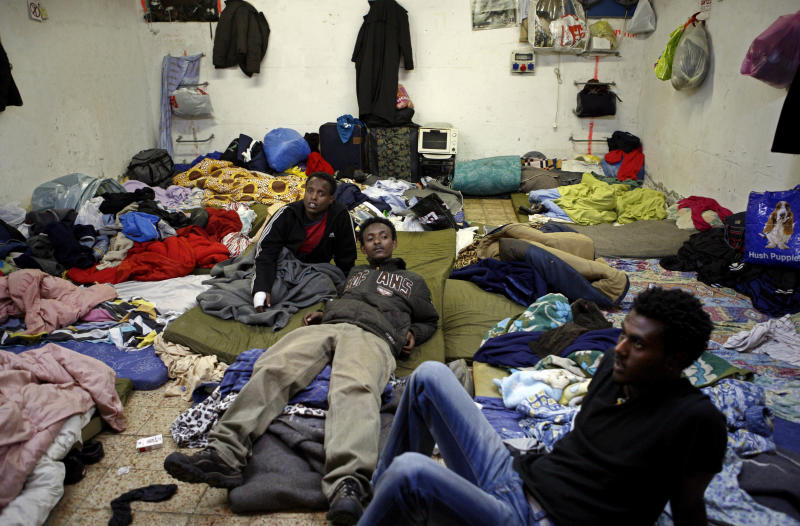 File - In this Monday, Feb. 25, 2008, file photo, Eritrean refugees sit in a shelter in Tel Aviv, Israel. The startling and sudden thaw between longtime enemies Eritrea and Ethiopia is opening up a world of possibilities for the countries' residents: new economic and diplomatic ties, telephone and transport links and the end to one of the most bitter feuds between neighbors. But the fledgling peace is raising new questions for Eritrea's diaspora, tens of thousands of people who fled the Eritrean government's tight grip, a rigid compulsory military and endemic poverty who are cautiously waiting to see how the truce will shape their homeland and perhaps offer them a chance to return. (AP Photo/Tara Todras-Whitehill, File)