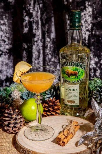 """<p>Shake 50ml <a href=""""https://www.amazon.co.uk/Zubrowka-Bison-Vodka-70-cl/dp/B00E9Z9LZC/ref=sr_1_1?dchild=1&keywords=%C5%BBubr%C3%B3wka+Bison+Grass%2C&qid=1605624861&s=grocery&sr=1-1"""" rel=""""nofollow noopener"""" target=""""_blank"""" data-ylk=""""slk:Żubrówka Bison Grass,"""" class=""""link rapid-noclick-resp"""">Żubrówka Bison Grass,</a> 2tsp honey, 50ml apple juice and 10ml cinnamon syrup together, before straining into a chilled glass. Pour 30ml double cream back into your shaker, give it a good shake and gently pour over a spoon into the martini glass to create a float. To garnish, lightly dust with ground cinnamon.</p>"""