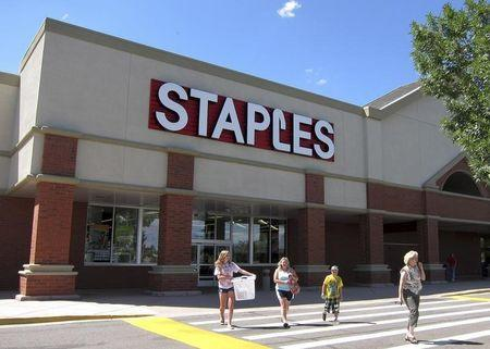 A family leaves the Staples store in Broomfield