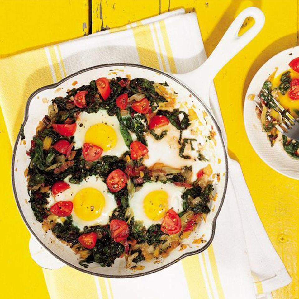 """<p>You'll find even more greens (plus tomatoes, onion, garlic, and eggs) in this super-easy skillet, which makes eating Mediterranean food both fun and about as healthy as it gets.</p><p><a href=""""https://www.prevention.com/food-nutrition/recipes/a20521017/chard-breakfast-skillet-with-egg-onion-and-tomato/"""" rel=""""nofollow noopener"""" target=""""_blank"""" data-ylk=""""slk:Get the recipe from Prevention »"""" class=""""link rapid-noclick-resp""""><strong><em>Get the recipe from Prevention »</em></strong></a></p>"""