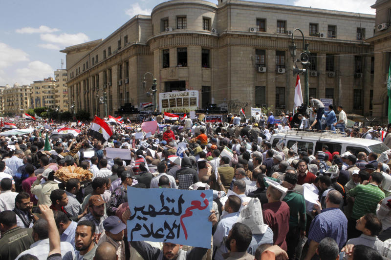 "Thousands of mostly Egyptian Muslim Brotherhood members shout slogans during a protest in front of the the Supreme Judicial Council in Cairo, Egypt, Friday, April 19, 2013. Arabic reads, ""yes to clean media."" Thousands of supporters of Egypt's Islamist president have taken to the streets of Cairo, calling on him to ""cleanse the judiciary."" Mohammed Morsi and the judiciary have had tense relations since he came to power in June last year. Judges accused him of trampling on their authority, while Morsi supporters charge that the judiciary is controlled by supporters of ousted President Hosni Mubarak. (AP Photo/Amr Nabil)"