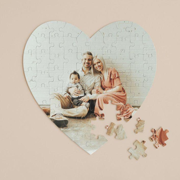"""<p>minted.com</p><p><strong>$42.00</strong></p><p><a href=""""https://go.redirectingat.com?id=74968X1596630&url=https%3A%2F%2Fwww.minted.com%2Fproduct%2Fheart-puzzle%2FMIN-02U-HZB%2Fthe-big-picture&sref=https%3A%2F%2Fwww.countryliving.com%2Flife%2Fg4248%2Ffirst-mothers-day-gifts%2F"""" rel=""""nofollow noopener"""" target=""""_blank"""" data-ylk=""""slk:Shop Now"""" class=""""link rapid-noclick-resp"""">Shop Now</a></p><p>A custom puzzle will give the new mom in your life something fun to work on. </p>"""