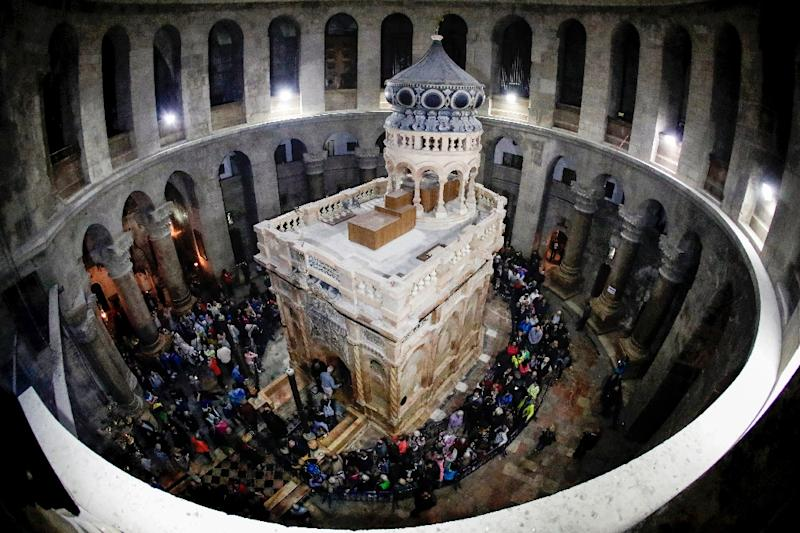 "A March 2017 picture shows the inside of the Church of the Holy Sepulchre in Jerusalem. The city's leading churches issued a rare statement condemning what they called Israeli attempts to ""weaken the Christian presence"" in the city (AFP Photo/THOMAS COEX)"