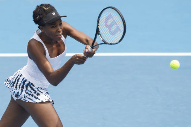 Venus Williams of the U.S. plays a shot against Serbia's Ana Ivanovic in the singles final at the ASB Classic women's tennis tournament at ASB Tennis Arena, in Auckland, New Zealand, Saturday, Jan. 4, 2014. (AP Photo/SNPA, David Rowland)