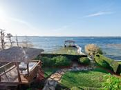<p>The mega mansion is perched on three acres overlooking Lake Butler.</p>