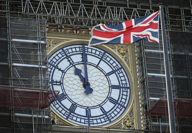 Big Ben's clock face marks eleven o'clock, starting a two minute silence to honour Armistice Day, at the Palace of Westminster in London, Monday Nov. 11, 2019. Locations across the country are marking guns falling silent to end hostilities and end World War One, on the eleventh hour of the eleventh day of the eleventh month of 1918. (Yui Mok/PA via AP)