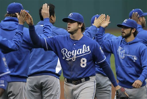 Kansas City Royals third baseman Mike Moustakas (8), relief pitcher Tim Collins, right, and the rest of the Royals celebrate their 4-2 over over the Cleveland Indians in a baseball game in Cleveland on Thursday, April 26, 2012. (AP Photo/Amy Sancetta)