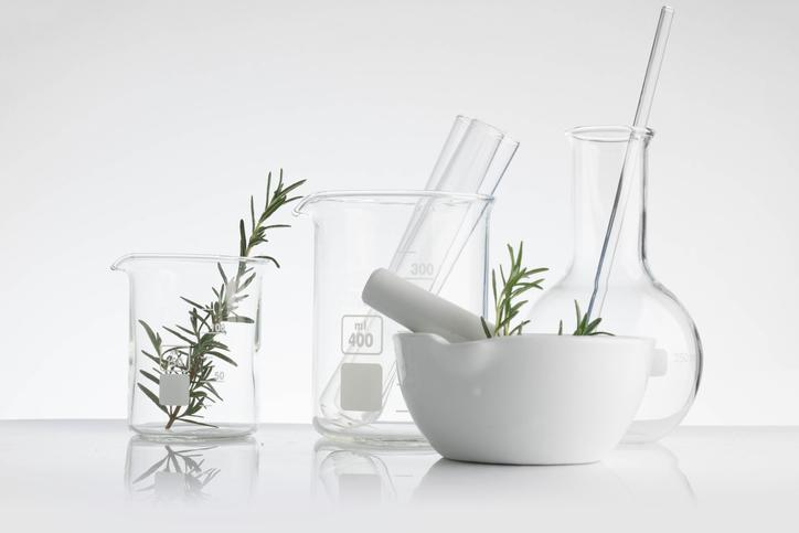 Glass beakers and a pestle.