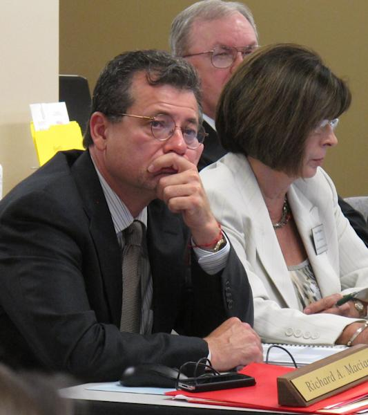 Kansas State Board of Healing Arts members, Richard Macias, left, and Anne Hodgdon, right, listen to arguments from attorneys before deciding to revoke the license of Dr. Ann Kristin Neuhaus over referrals of patients for late-term abortions, Friday, June 22, 2012, in Topeka, Kan. (AP Photo/John Hanna)