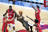 Chicago Bulls' Coby White, center, shoots between four New Orleans Pelicans defenders during the first half of an NBA basketball game Wednesday, Feb. 10, 2021, in Chicago. (AP Photo/Charles Rex Arbogast)