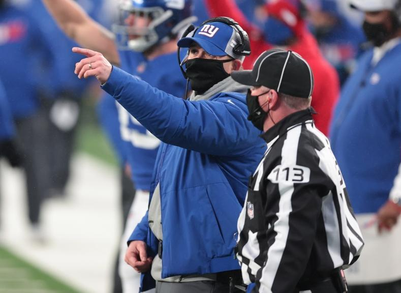Jan 3, 2021; East Rutherford, NJ, USA; New York Giants head coach Joe Judge talks with an official against the Dallas Cowboys in the second half at MetLife Stadium. Mandatory Credit: Vincent Carchietta-USA TODAY Sports