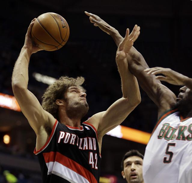 Portland Trail blazers' Robin Lopez (42) goes up for a shot against the Milwaukee Bucks' Ekpe Udoh, right, during the first half of an NBA basketball game on Wednesday, Nov. 20, 2013, in Milwaukee. (AP Photo/Jeffrey Phelps)