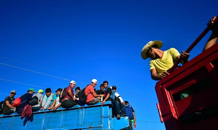 """<span class=""""element-image__caption"""">Thousands of mostly Honduran migrants crowded into the Mexican border city of Tapachula over the weekend after trekking on foot from the Guatemalan border.</span> <span class=""""element-image__credit"""">Photograph: AFP/Getty Images</span>"""