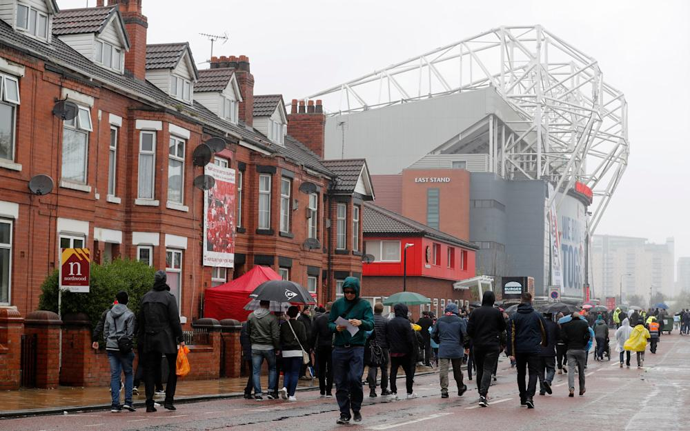 old trafford is raining - Credit: REUTERS
