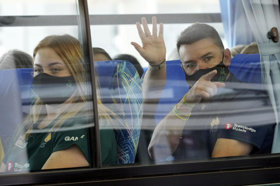 Australia's Olympic softball squad board a bus upon arrival at Narita international airport, Tuesday, June 1, 2021, in Narita, east of Tokyo. Australia's Olympic softball squad touched down in Japan on Tuesday and was among the earliest arrivals for the Tokyo Games.(AP Photo/Eugene Hoshiko, Pool)