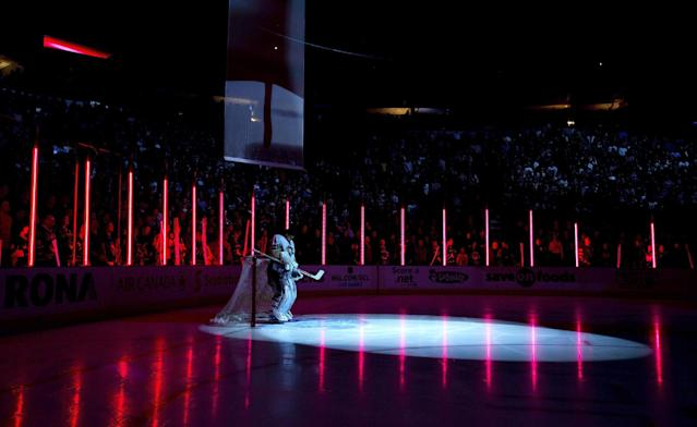 """Pittsburgh Penguins goalie Marc-Andre Fleury stands in front of his goal during the singing of """"O Canada"""" before the Penguins' NHL hockey game against the Vancouver Canucks in Vancouver, British Columia, on Tuesday, Jan. 7, 2014. (AP Photo/The Canadian Press, Darryl Dyck)"""