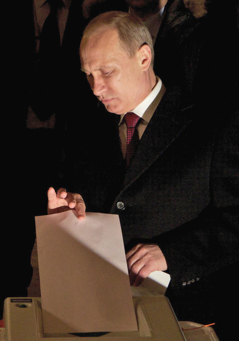 Russian Prime Minister and presidential candidate Vladimir Putin casts his ballot at a polling station  in Moscow, Russia, Sunday, March 4, 2012. Polling stations have opened across Russia's vast expanse for the presidential election widely expected to return Vladimir Putin to the Kremlin. (AP Photo/Ivan Sekretarev)