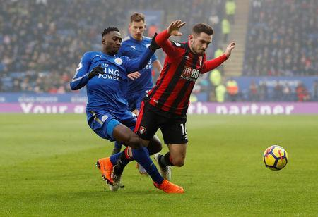 FILE PHOTO - Soccer Football - Premier League - Leicester City vs AFC Bournemouth - King Power Stadium, Leicester, Britain - March 3, 2018 Leicester City's Wilfred Ndidi in action with Bournemouth's Lewis Cook REUTERS/Darren Staples