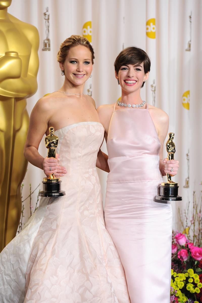 So this is a two-for-one. On the night where it was win-win for both actresses, Jennifer Lawrence and Anne Hathaway both wore beautiful blush coloured dresses. Lawrence went for a Dior gown with trail whereas Hathaway went for a more modern silk Prada choice.