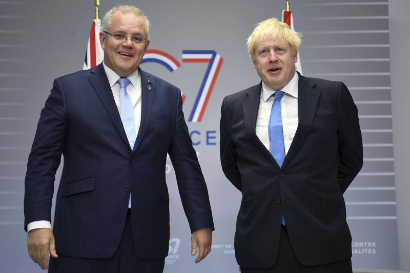 British Prime Minister Boris Johnson, right, meets Australian Prime Minister Scott Morrison for bilateral talks during the G-7 summit in Biarritz, France,Monday Aug. 26, 2019. (Neil Hall/PA via AP)