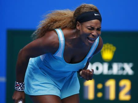 Serena Williams of the U.S. reacts after winning a point during her women's singles match against Silvia Soler-Espinosa of Spain at the China Open tennis tournament in Beijing