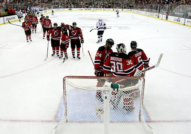 NEWARK, NJ - JUNE 09: The New Jersey Devils celebrate around Martin Brodeur #30 after defeating the Los Angeles Kings during Game Five of the 2012 NHL Stanley Cup Final at the Prudential Center on June 9, 2012 in Newark, New Jersey. (Photo by Elsa/Getty Images)