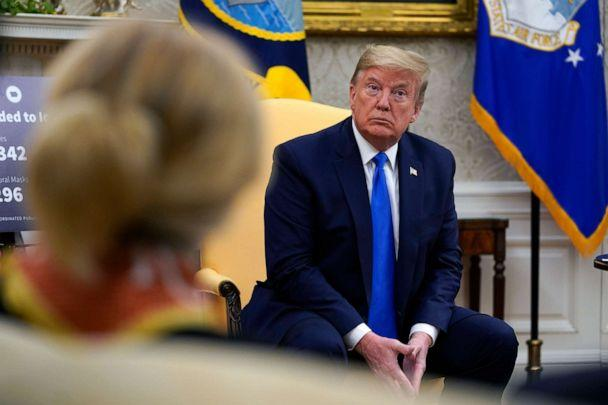 PHOTO: President Donald Trump listens during a meeting with Gov. Kim Reynolds, R-Iowa, in the Oval Office of the White House, May 6, 2020, in Washington.  (Evan Vucci/AP, FILE)