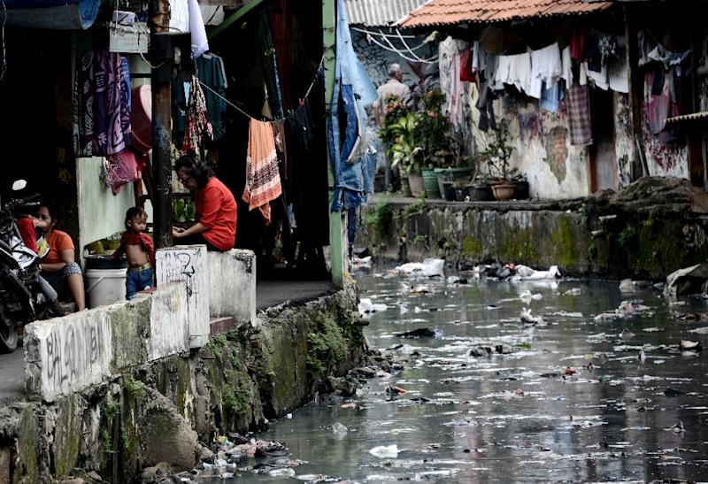 Narrow ducts that run from Jakarta's main waterways and through slums are often filled with rubbish due to the lack of a decent disposal system (AFP Photo/GOH CHAI HIN)