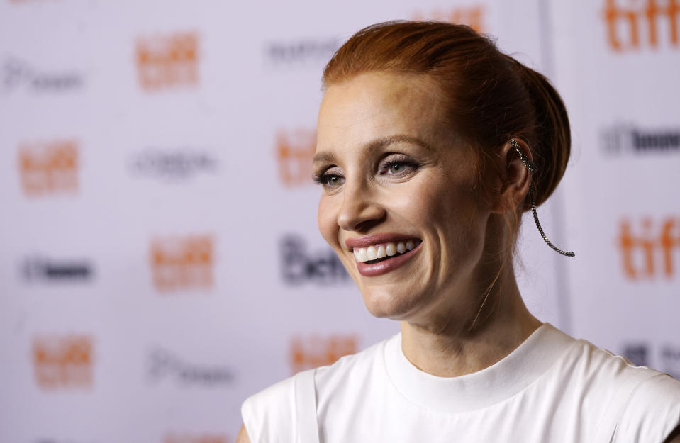"""Jessica Chastain, a cast member in """"The Eyes of Tammy Faye,"""" smiles at the premiere of the film at the 2021 Toronto International Film Festival, Sunday, Sept. 12, 2021, in Toronto. (AP Photo/Chris Pizzello)"""