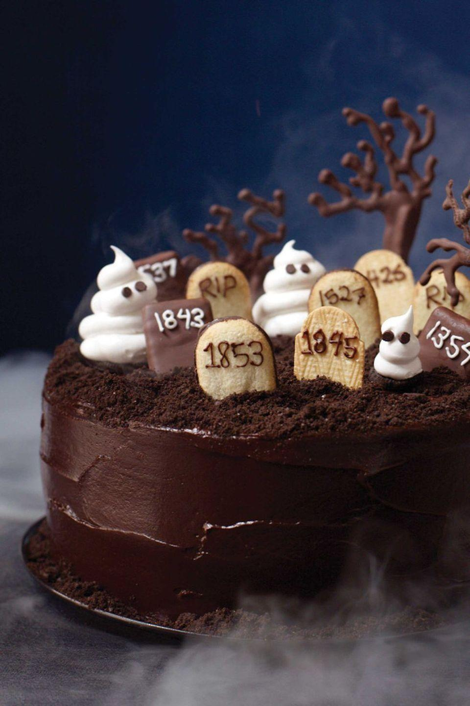 """<p>Bury those chocolate cravings for good with this rich layer cake that's spook-tacular for Halloween and a sensational choice year-round with an espresso-tinged batter and bittersweet chocolate frosting. Just don't include the mini graveyard during the other months of the year.</p><p><a href=""""https://www.womansday.com/food-recipes/food-drinks/recipes/a11822/graveyard-cake-recipe-123437/"""" rel=""""nofollow noopener"""" target=""""_blank"""" data-ylk=""""slk:Get the recipe for Graveyard Cake."""" class=""""link rapid-noclick-resp""""><em>Get the recipe for Graveyard Cake.</em></a></p>"""