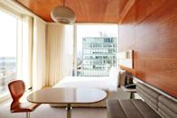 <p><strong>How did it strike you on arrival?</strong><br> At once futuristic and retro, the hotel almost feels like a scene out of <em>The Jetsons</em>, with mid-century-inspired furniture and lighting, all in a blocky concrete hulk that seems to float above the High Line park.</p> <p><strong>Nice. What's the crowd like?</strong><br> The hotel's neighborhood, the Meatpacking District, is full of cutting-edge shops, restaurants, and (nearby) art galleries, and the Standard is full of people you'd expect to see at those places.</p> <p><strong>Most importantly: Tell us about your room.</strong><br> The first thing you notice about the room isn't really the room itself, but the views out of the floor-to-ceiling windows (of either the Hudson River or the city), which are truly the main reason to choose this hotel. They're that good. The design is minimal, sleek and clean-lined, with white being the main color.</p> <p><strong>We're craving some deep, restorative sleep. They got us?</strong><br> The bed is great for a good night's sleep.</p> <p><strong>How about the little things, like mini bar, or shower goodies. Any of that worth a mention?</strong><br> If money was no object, we'd raid the minibar to make a Grey Goose and soda while watching the sunset.</p> <p><strong>Please tell us the bathroom won't let us down.</strong><br> While bathrooms and showers are just big enough, hopefully you're very comfortable with the person you're traveling with, as there's nothing between the shower and the bedroom except a clear pane of glass. Custom bath products are pleasantly fragrant.</p> <p><strong>Maybe the most important topic of all: Wi-Fi. What's the word?</strong><br> Fast, free Wi-Fi.</p> <p><strong>Anything stand out about other services and features? Whether it's childcare, gyms, spas, even parking—whatever stuck with you.</strong><br> Even if you aren't big on working out, check out the 17th-floor gym for sweeping Hudson River views. And if you're a night owl, head up to