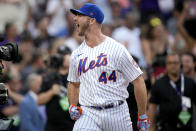 National League's Pete Alonso, of the New York Mets, cheers during the first round of the MLB All Star baseball Home Run Derby, Monday, July 12, 2021, in Denver. (AP Photo/David Zalubowski)