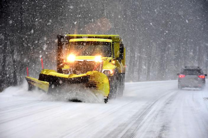 A snow plow clears the road surface on Route 7, Sunday, Dec. 1, 2019 in New Ashford, Mass. A powerful winter storm that's been tormenting travelers across the U.S. since before Thanksgiving moved to the Northeast on Sunday, packing one last punch of snow and ice as people make their way home after the holiday weekend.