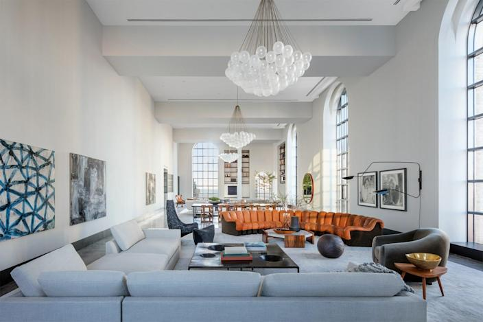 """""""The penthouse of One Hundred Barclay is quintessential 'downtown,' and the space itself is so grand in terms of size and in terms of history, it was a natural choice to use furnishings that have an edge but still have that feel of being perfectly timeless,"""" explains the designer. Large-scale art also makes use of the immense amount of wall space."""