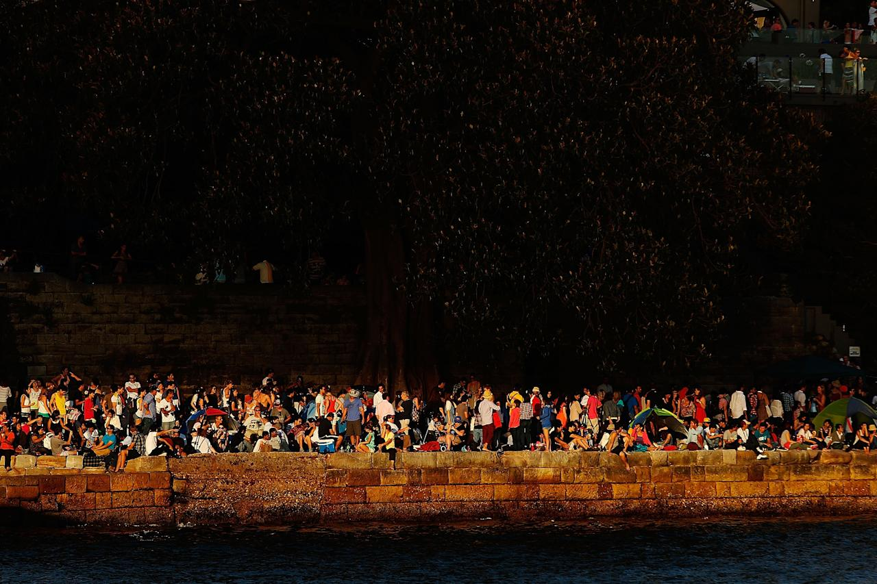 SYDNEY, AUSTRALIA - DECEMBER 31:  People line the harbour in anticipation of New Years Eve celebrations on Sydney Harbour on December 31, 2012 in Sydney, Australia.  (Photo by Brendon Thorne/Getty Images)