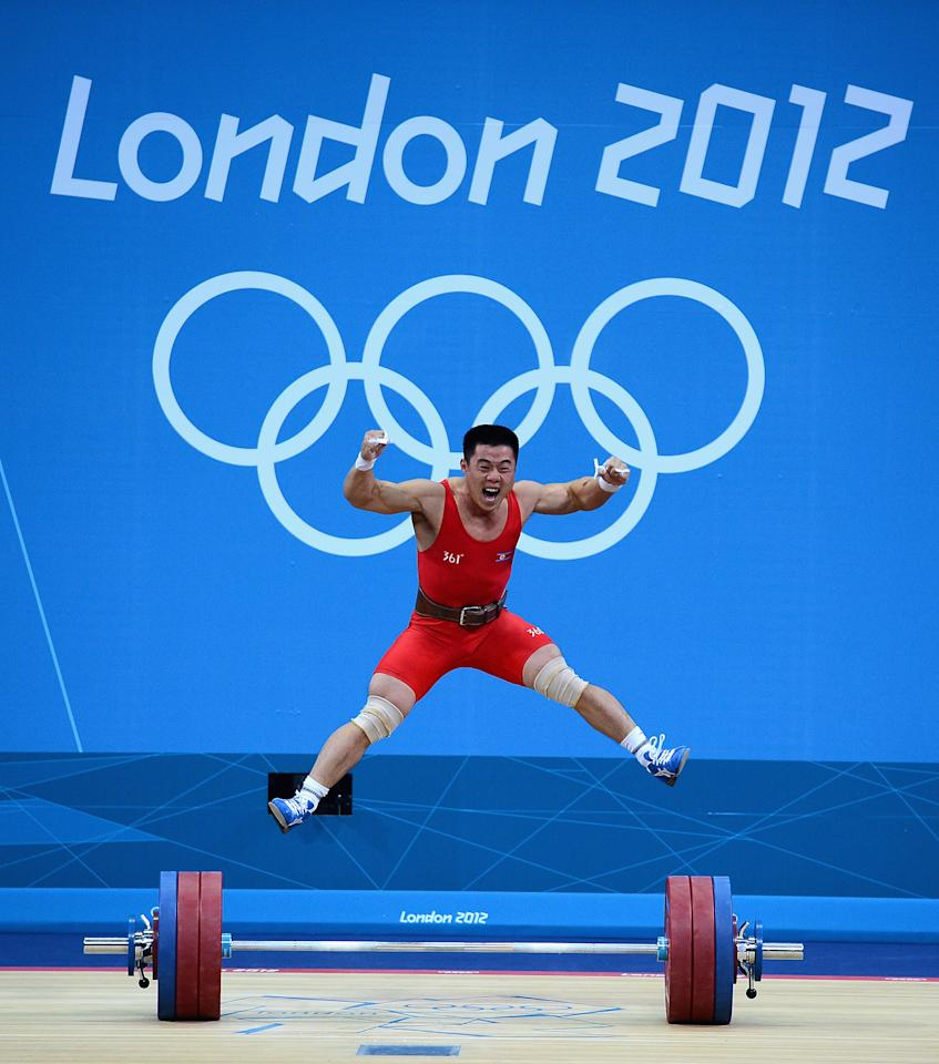 LONDON, ENGLAND - JULY 30: Un Guk Kim of DPR Korea celebrates making a world record while competing in the Men's 62kg Weightlifting on Day 3 of the London 2012 Olympic Games at ExCeL on July 30, 2012 in London, England.  (Photo by Laurence Griffiths/Getty Images)