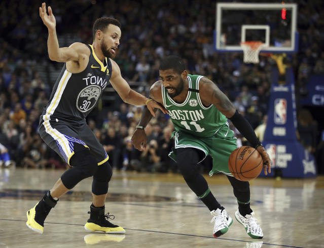 "<a class=""link rapid-noclick-resp"" href=""/nba/teams/bos/"" data-ylk=""slk:Boston Celtics"">Boston Celtics</a>' <a class=""link rapid-noclick-resp"" href=""/nba/players/4840/"" data-ylk=""slk:Kyrie Irving"">Kyrie Irving</a>, right, drives the ball against <a class=""link rapid-noclick-resp"" href=""/nba/teams/gsw/"" data-ylk=""slk:Golden State Warriors"">Golden State Warriors</a>' <a class=""link rapid-noclick-resp"" href=""/nba/players/4612/"" data-ylk=""slk:Stephen Curry"">Stephen Curry</a> duringing the second half of an NBA basketball game Saturday, Jan. 27, 2018, in Oakland, Calif. (AP Photo/Ben Margot)"