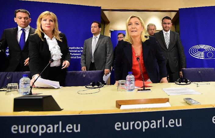 France's far-right National Front party leader Marine Le Pen (C) arrives at a press conference at the European Parliament in Brussels on June 16, 2015, with European Parliament member Janice Atkinson (2nd L) (AFP Photo/Emmanuel Dunand)