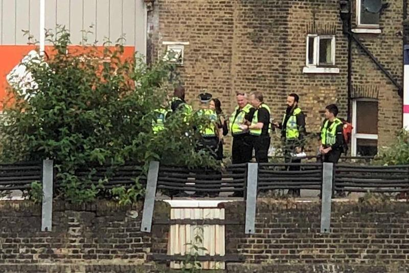 Police at the scene near Brixton after three people died when they were hit by a train