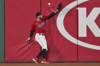 Cleveland Indians' Tyler Naquin can't make the catch on an RBI double hit by Milwaukee Brewers' Keston Hiura in the seventh inning in a baseball game, Friday, Sept. 4, 2020, in Cleveland. (AP Photo/Tony Dejak)