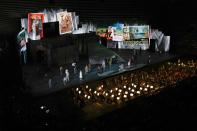 A view of the stage during 'I Pagliacci' (The Clowns) lyric opera, at the Arena di Verona theatre, in Verona, Italy, Friday, June 25, 2021. The Verona Arena amphitheater returns to staging full operas for the first time since the pandemic struck but with one big difference. Gone are the monumental sets that project the scene to even nosebleed seats in the Roman-era amphitheater, replaced by huge LED screens with dynamic, 3D sets that are bringing new technological experiences to the opera world. (AP Photo/Luca Bruno)