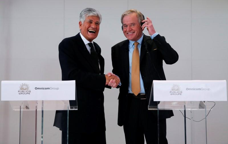Publicis Chief executive Levy and Omnicom Group head Wren react during a joint news conference in Paris