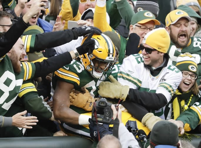 Green Bay Packers' Aaron Jones celebrates a touchdown run with Packers fans last season. (AP)