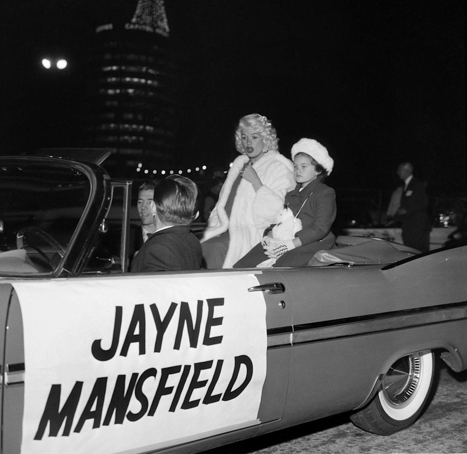<p>You couldn't miss Jayne Mansfield as she and her daughter rode through the Christmas parade in Hollywood in 1958. </p>