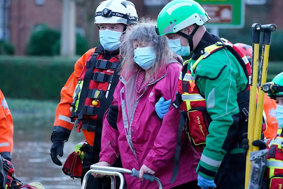 Elderly residents are evacuated from a local care home by emergency services in Northwich. (Photo: Christopher Furlong via Getty Images)