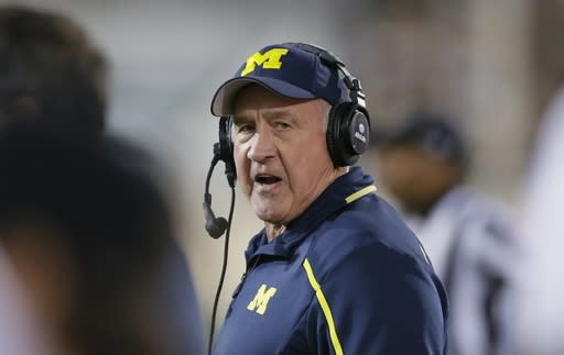 FILE - In this Saturday, Oct. 25, 2014 file photo, Michigan defensive coordinator Greg Mattison walks the sidelines during the second half of an NCAA college football game against Michigan State in East Lansing, Mich. New Ohio State coach Ryan Days 10 assistant coaches will be paid a total of more than $7.4 million this year. Contracts of the assistants were released by Ohio State on Monday, March 11, 2019. Co-defensive coordinator Greg Mattison tops the list at $1.1 million.(AP Photo/Carlos Osorio, File)