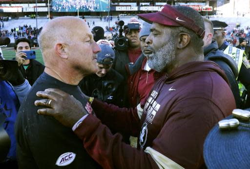 Boston College head coach Steve Addazio, left, and Florida State interim head coach Odell Haggins speak at midfield after an NCAA college football game, Saturday, Nov. 9, 2019, in Boston. (AP Photo/Bill Sikes)