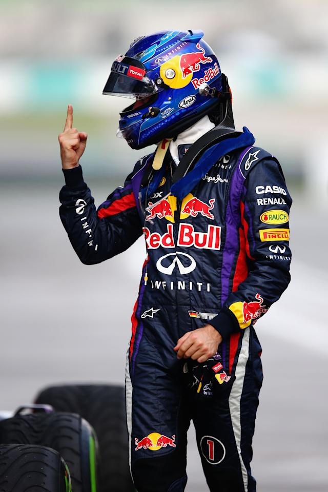 KUALA LUMPUR, MALAYSIA - MARCH 23:  Sebastian Vettel of Germany and Infiniti Red Bull Racing celebrates finishing first during qualifying for the Malaysian Formula One Grand Prix at the Sepang Circuit on March 23, 2013 in Kuala Lumpur, Malaysia.  (Photo by Paul Gilham/Getty Images)