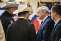 Former President Donald Trump greets law enforcement while arriving at a border security briefing to discuss further plans in securing the southern border wall on Wednesday, June 30, 2021, in Weslaco, Texas. (Brandon Bell/Pool via AP)
