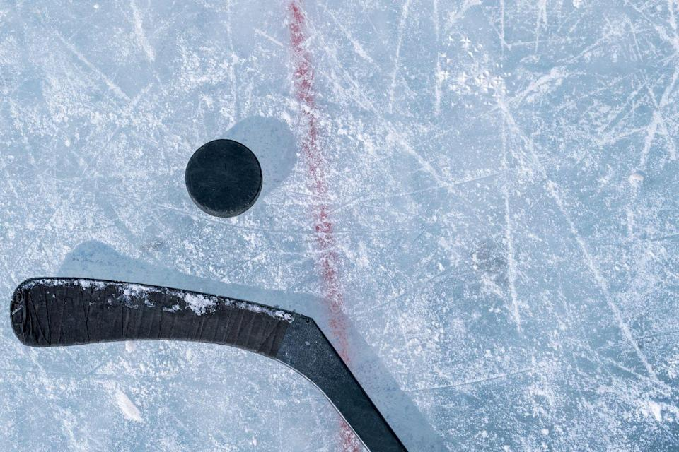 <p>If your S.O. is the sporty type, they'll love this type of outing—even if it means sitting in a chilly ice rink. Buy some beers and get cozy; watching grown men throw each other against the wall is surprisingly entertaining. </p>